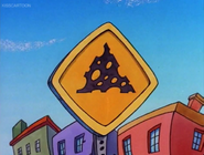 Cheese crossing sign (Rocko's Modern Life, Driving Mrs. Wolfe)