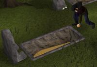 Gravedigger digging up or burying a coffin