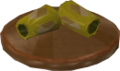 Reinald's Smithing Emporium Gold armguards stand.png