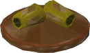 File:Reinald's Smithing Emporium Gold armguards stand.png