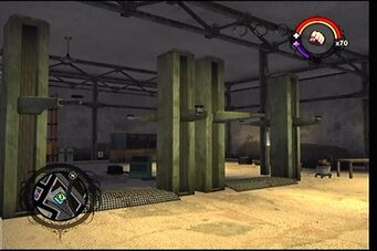 Donnie's second garage as it appears in Saints Row - interior work area car lifts
