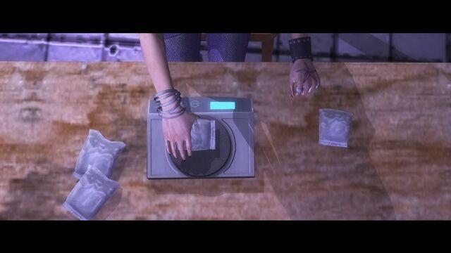 File:Veteran Child - Shaundi weighing bags of Loa Dust.jpg