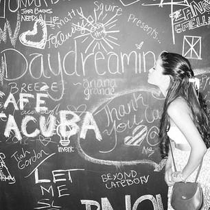 File:Ariana next to a chalkboard.jpg