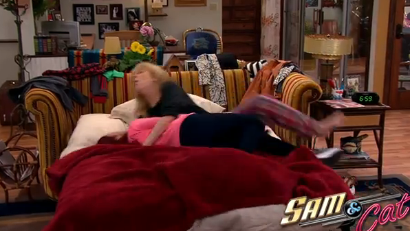 File:Cat forces Sam onto the sofabed in first promo.png