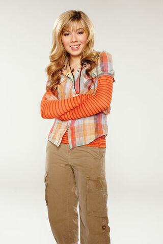 File:Sam wearing orange with her arms crossed.jpg