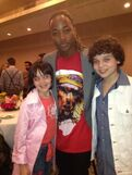 Cameron and his sister with Leon Thomas at 2013 KCA party