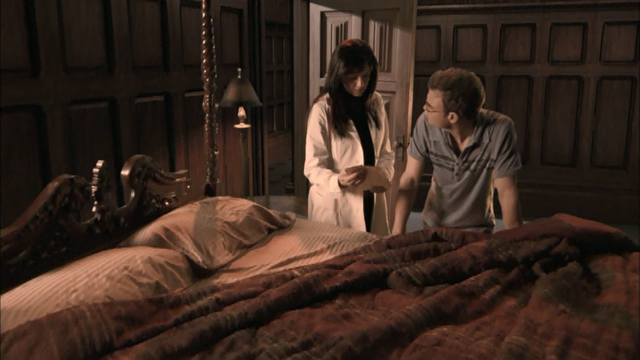 File:0x03 Helen and Will looking at Druitt's clue.png