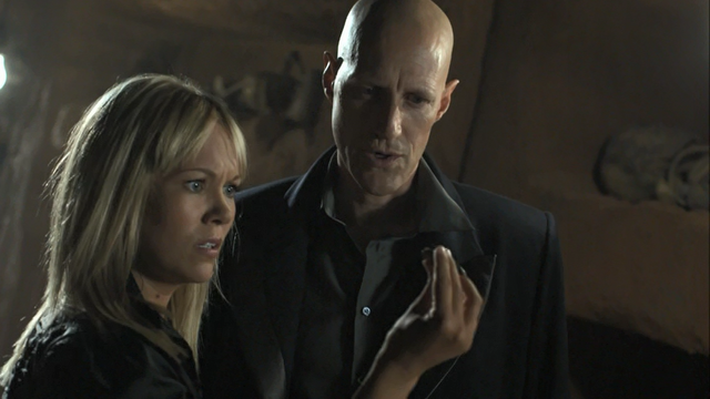File:1x07 Ashley and Druitt with Magnus' bullet casing.png