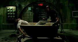 Saw v bathtub trap