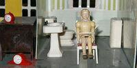 Der Vater und die Puppe