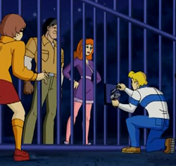 File:Daphne in Wakumi's cage.png