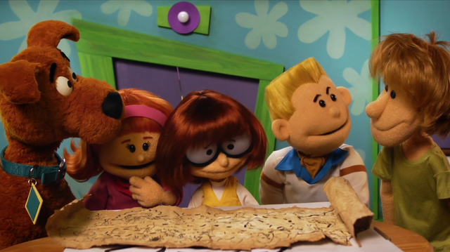 File:Gang look over map (puppet film).png