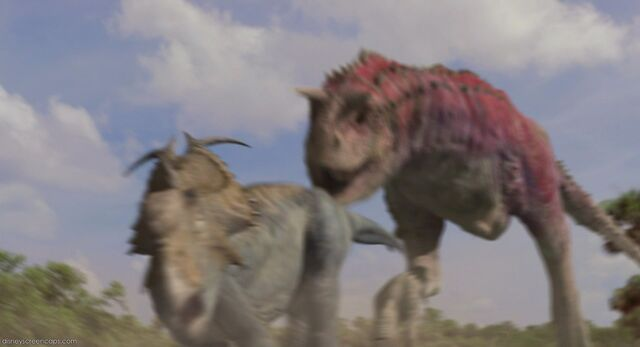 File:Mean Dinosaur Chasing Another Dinosaur.jpg