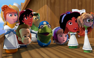 Kermit and friends are look at the giant wave