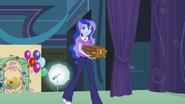 Vice-principal Luna walks on stage EG