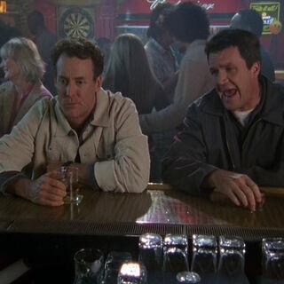 Janitor and Cox talk at the bar