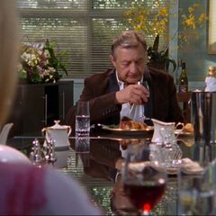 Elliot and Kelso are now married but appear to be sitting opposite each other at a long table