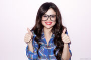 Selena Gomez wearing glasses