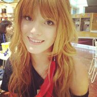 Bella-thorne-red-feather-earring