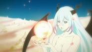 Amira receiving her pendant
