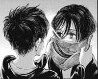 Eren wraps his scarf around Mikasa