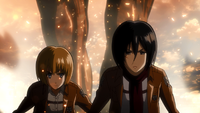 Mikasa and Armin followed by Titan Eren
