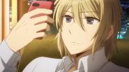 Madoka looking at his phone