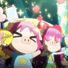 Pig macaroon in the audience with two other fans cheering on Trichronika