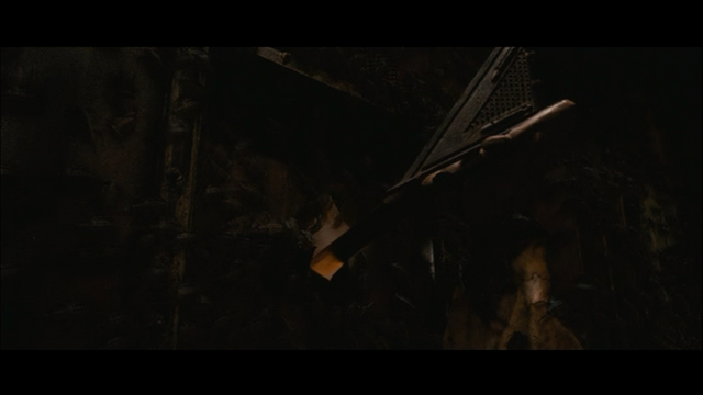 File:Pyramid Head Tries to Open the Locked Door.png