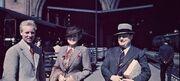 Three Aquitanians waiting at a Savoy's Bahnhof, 1958