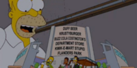 Springfield Estadio de Toros (initially the Duff Beer Krusty Burger Buzz Cola Costington's Department Store Kwik-E-Mart Stupid Flanders Park)