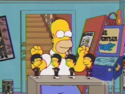 File:Homer playing Ned's Beatles.jpg