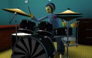 Toy Charlie plays his drum
