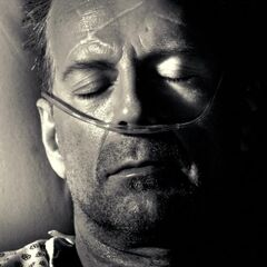 John, in a coma.