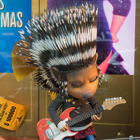 Life-size figure of Ash sitting inside a window at Bloomingdale's in New York City, New York