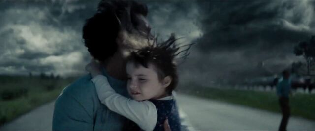 File:Man-of-Steel-Trailer-Images-Clark-Kent-Escaping-Tornado-with-Child-In-Arms.jpg