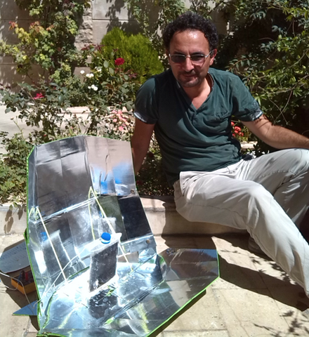 File:Amir Komarizade with unique water vessel, 12-14-15.png