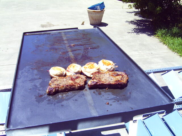 File:Ribeye steaks and bacon wrapped chicken breasts cooking on the Solar Fryer.JPG