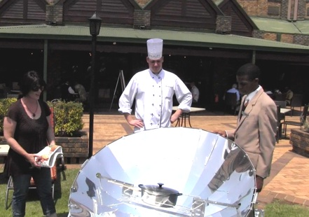 File:Thea Holm demonstrates solar cooking to chef, 2-21-13.jpg