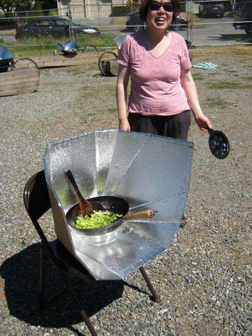 File:Caicai Wu demonstates stir fry, 7-25-13.jpg