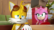 Amy looking at Tails