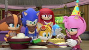 Team Sonic looking at the scrapbook