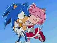Amy hugging Sonic tightly