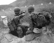 220px-ARVN Recruit Trains with M16 Rifle