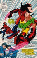 Spider-Girl kicking Wild Thing