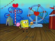 Spongebob Wearing 1 hat & holding cotton Candy & 1 Krabby Patty @ the Valentine's Day Carnival