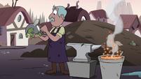 S3E4 Mewman blacksmith taps turtle's iron shell