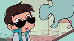 S2E17 Marco Diaz listening to Pony Head