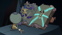S2E35 Glossaryck opens the book to Eclipsa's chapter