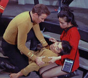 Kirk and Takayama tend to Sulu